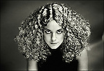 A young woman with curly hair