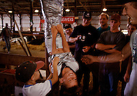 Tim Hein, 9, laughs after being duct taped to a pole in a cow barn at the Nobles County Fair in Minnesota.