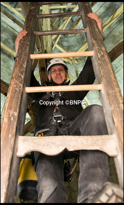BNPS.co.uk (01202 558833)<br /> Pic: TomWren/BNPS<br /> <br /> Clerk of the Works, Gary Price heads up one of ten ladders to reach the weather door.<br /> <br /> How many men does it take to change a lightbulb... at the top of Britain's tallest spire.<br /> <br /> When your office is Salisbury Cathedral the simple task of changing a light bulb involves four men, a 404ft climb and takes three hours.<br /> <br /> Ecclesiastical carpenter Richard Pike needed a head for heights when he joined Gary Price, who is in charge of conservation, to make the daring ascent with two rope specialists to ensure their safety. <br /> <br /> Despite working at the cathedral for 27 years, it was the first time Richard has ever made the hair-raising climb.