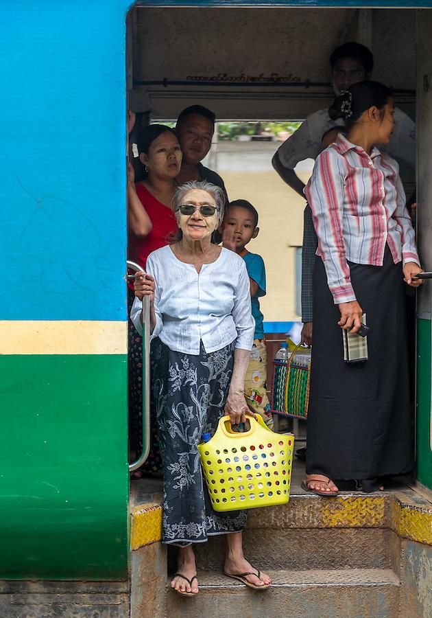 YANGON, MYANMAR - CIRCA DECEMBER 2013: Passengers in a train arriving at the Yangon Central Railway Station