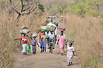 People make their way to market in the village of Nyei, in Southern Sudan.