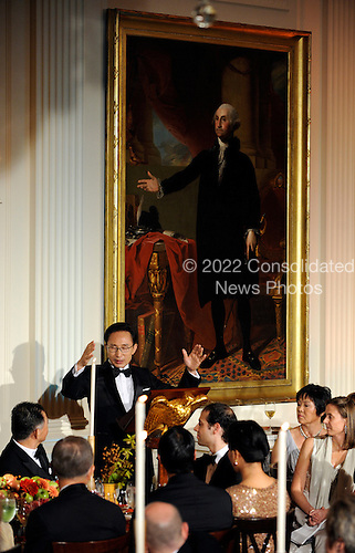 President Lee Myung-bak of South Korea toasts United States President Barack Obama during a State Dinner in the East Room of the White House in Washington, DC on Thursday, October 13, 2011. The State Visit comes only a day after Congress passed a free trade agreement with South Korea.  .Credit: Roger L. Wollenberg / Pool via CNP