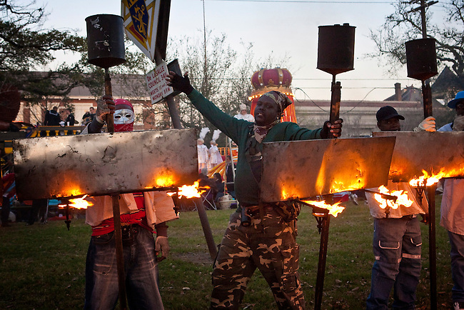 One of the oldest traditions of Mardi Gras, Flambeaux carrying burning kerosene torches before parading during Mardi Gras in the Uptown area of New Orleans, Louisiana, USA.