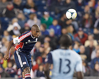 New England Revolution defender Jose Goncalves (23) heads the ball.  In the first game of two-game aggregate total goals Major League Soccer (MLS) Eastern Conference Semifinal series, New England Revolution (dark blue) vs Sporting Kansas City (light blue), 2-1, at Gillette Stadium on November 2, 2013.