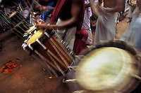 Uddukkus(drums from kerala) are being played during the Pulikali festival, Trichur, Kerala, India..Pulikali or Kaduvvakali is a two hundred year old folk dance form, practised mostly in Thrissur and Palghat districts of Kerala. It liberally makes use of forms and symbols of nature that finds expression in its bright, bold body painting and high-energy dance movements. The philosophy of Pulikali is that human and nature are integral parts of each other. So by fusing man and beast in its artistic language, it flamboyantly celebrates the connection. Arindam Mukherjee