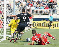 Sebastien Le Toux #9 of the Philadelphia Union tries to get round Stefan Frei #24 of Toronto FC during an MLS match at PPL stadium in Chester, PA. on July 17 2010. Union won 2-1 with a last minute penalty kick goal.