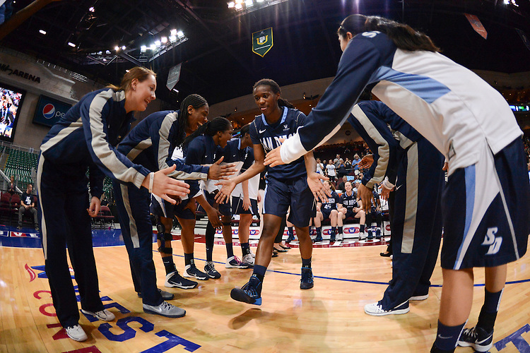 March 7, 2014; Las Vegas, NV, USA; San Diego Toreros forward Malina Hood (2) high-fives teammates against the Saint Mary's Gaels before the game of the WCC Basketball Championships at Orleans Arena.