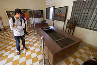 Phnom Penh, Cambodia. Tuol Sleng Genocide Museum at the former Security Prison 21 (S-21) of the Khmer Rouge. Waterboard and torture scenes by artists and former inmates who survived.