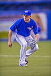 4 April 2015: Toronto Blue Jays infielder Steve Tolleson warms up prior to an exhibition game against the Cincinnati Reds at Olympic Stadium in Montreal, Quebec, Canada. The Blue Jays defeated the Reds 9-1 in the second of two MLB weekend exhibition games. Mandatory Credit: Ed Wolfstein Photo *** RAW (NEF) Image File Available ***