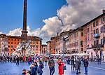 Tourists and locals gather around the famous Fountain of Four Rivers to enjoy the weekend art show and surrounding cafes in the Piazza Navona in Rome, Italy. (HDR image)