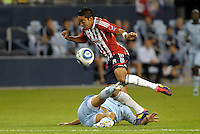Marco Fabian (8) Chivas Guadalajara midfielder tries to get by Sporting KC defender Aurelien Collin... Sporting Kansas City played Chivas Guadalajara to a 2-2 tie at LIVESTRONG Sporting Park, Kansas City, Kansas in an international friendly.