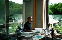 Germany, Freiburg , l'architetto Rolf Disch, tra i fautori del progetto Vauban....Germany, Freiburg, architect Rolf Disch in his office Sonnenshiff (sun Ship), with improved low energy standard houses on the roof. the building and the houses are the most popular in Vauban area
