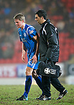 St Johnstone v Dundee United....22.02.11 .Jamie Adams is helped of the pitch after injuring his right leg.Picture by Graeme Hart..Copyright Perthshire Picture Agency.Tel: 01738 623350  Mobile: 07990 594431