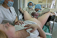 Galina Belaya, 23, has her baby at the Moscow Planning Center and Reproduction Maternity Home. ..The maternity home delivers about 8000 children a year... about 20 a day or so... This is the most of any maternity hospital in Russia.  There are 117,000 delivered in 2009 in all of Moscow.  1,800,000 were born in Russia in 2009 which is 27,000 more than the deaths that year.  So Russia is basically at the replacement rate, but there are not as many breeders in the lineup moving forward... so the state has instituted a number of policies including free housing for immigrants and a one time payment of over $10,000 for a woman to have either the 2nd, 3rd or 4th baby.