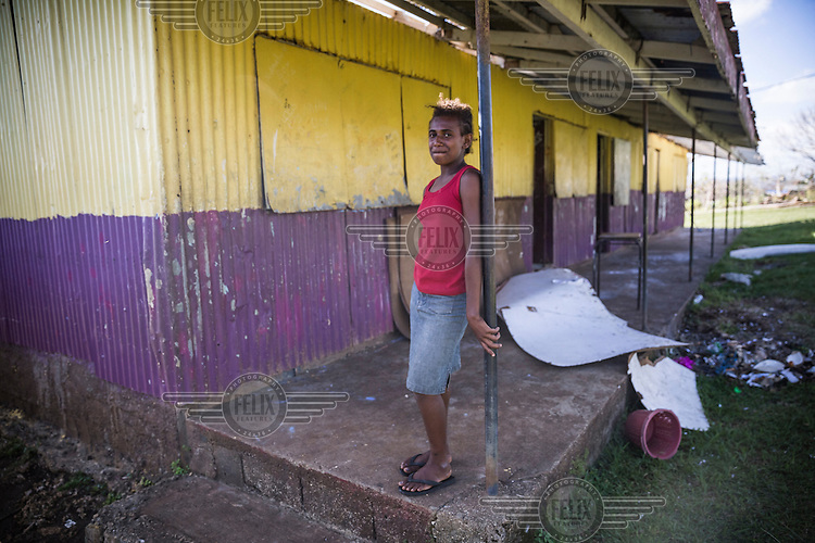 12 year old student Pamela stands beside her classroom destroyed by Cyclone Pam on 13 March 2015. She says: 'The Cyclone left us without classes for more then two weeks. Me and my friends really hope that the damaged buildings will soon be repaired and we can go to school again.'