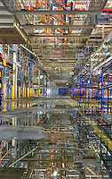 Reflection in water after a heavy rain at the door line area in the back of the Chrysler Newark main assebly plant, return seat carriers above