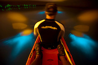 Kayaking Mosquito Bay (Bio Bay) at night with the glowing bioluminescence in the paddle wash.<br />