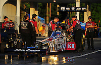 May 4, 2012; Commerce, GA, USA: Crew members surround the car of NHRA top fuel dragster driver Shawn Langdon during qualifying for the Southern Nationals at Atlanta Dragway. Mandatory Credit: Mark J. Rebilas-