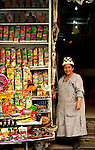 """Indigenous Aymaran shopkeeper poses at her shop in the Witches' Market also known as the """"Mercado de las Brujas"""" in La Paz, Bolivia.  The Witches' Market sells herbs, folk remedies and other ingridients to help with the many spirits of the Aymaran world."""