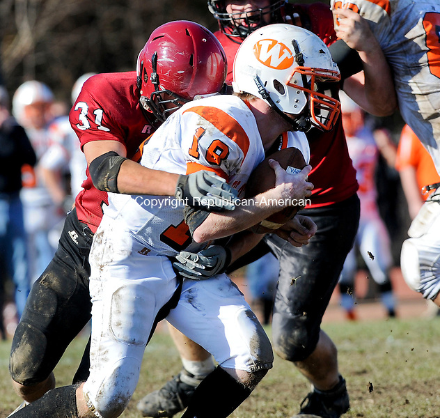 TORRINGTON, CT 22 NOVEMBER- 112212JS24- Watertown's Andrew Biello (18) is sacked by Torrington's Anthony Marinelli (31) during their annual Thanksgiving Day game Thursday at Torrington High School. .Jim Shannon Republican American