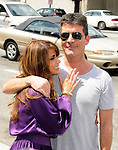 Paula Abdul and Simon Cowell 2011 at the first Judged auditions for X Factor at Galen Center in Los Angeles, May 8th 2011..Photo by Chris Walter/Photofeatures