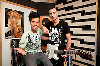 Switzerland. Canton Ticino. Losone. The brothers Ivan and Gabriel Broggini of the band Sinplus will represent Switzerland with their song Unbreakable at the Eurovision Song Contest 2012 in Baku. Gabriel Broggini (L) is the singer and his brother Ivan (R) plays the guitar. They both stand in the musical studio, where they rehearse their parts. 11.12.2011 © 2011 Didier Ruef