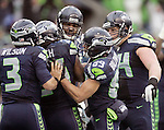 Seattle Seahawks quarterback Russell Wilson (3) after celebrates with   running back Marshawn Lynch after lynch ran for a 15-yard touchdown against the New Orleans Saints  during the 2nd round in a NFL Western Division playoff game at CenturyLink Field in Seattle, Washington on January 11, 2014.  Lynch rushed for 140 yards on 28 carries and scored two touchdowns as the Seahawks knock off the Saints 23-15 to hoist NFC Championship game.  ©2014. Jim Bryant Photo. ALL RIGHTS RESERVED. Seahawks beat the Saints 22-15 to take home-field advantage in the NFL Championship Game. ©2014. Jim Bryant Photo. ALL RIGHTS RESERVED.