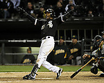 CHICAGO - APRIL 12:  Alexei Ramirez #10 of the Chicago White Sox hits a walk-off game winning home run off of Bobby Cramer #26 of the Oakland Athletics in the 10th inning on April 12 00, 2011 at U.S. Cellular Field in Chicago, Illinois.  Ramirez hit two home runs on the night. The White Sox defeated the Athletics 6-5.  (Photo by Ron Vesely)  Subject: Alexei Ramirez;Bobby Cramer.