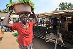 Margaret Dure carries her produce through the market in Yei, Southern Sudan. She and several other women in the market have received support from a microfinance program run by the United Methodist Women in Yei. NOTE: In July 2011, Southern Sudan became the independent country of South Sudan