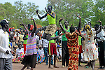 In this traditional Dinka dance, the women dance in a circle, as the men take turns jumping into the air. The women hold their arms up in the shape of a cow's horns.  Every weekend in Rumbek, South Sudan, people gather to dance in the town's Freedom Square.