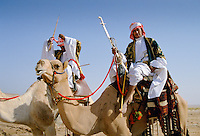 Camels and arab riders in desert Riyadh, Saudi Arabia