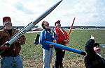 Rocketeers watch a rocket launch at an amateur rocket festival..Manchester, Tennessee.