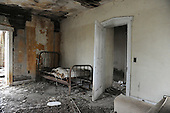Abandoned Hotel, debris, dilapidated furniture, Iron Bed Frame, torn mattress,  white door with moulding, plaster debris, open plaster walls, Columbus Junction, Eastern Iowa, abandoned structures,