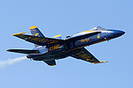 Blue Angel #5, the lead solo, enters the airshow box enroute to a head on pass with Blue Angel #6 as part of the Blue Angels flight demonstration over San Francisco Bay. The Blue Angels were the featured aerial performers of the 2006 San Francisco Fleet Week event. The Blue Angels fly the Boeing built F/A-18 Hornet. Photographed 10/06