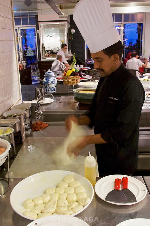 Malaysia, Penang. E&O - the Eastern & Oriental Hotel. Breakfast buffet at Sarkies restaurant. Roti chef.