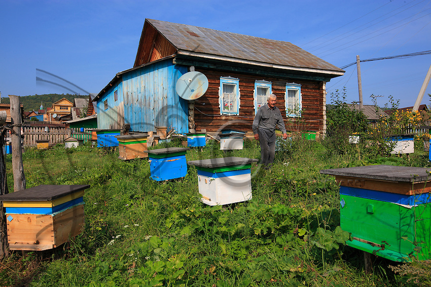 Rafic Yumaguzhin, 54 years old, beekeeper like his father, surrounded by his 40 hives in his garden in the village of Gadel-Gareyéro.