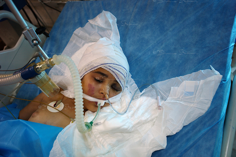 Tripoli, Libya, August 25, 2011.Hala Salem, 10, has received a bullet in the head and is in a coma. Tripoli central hospital operates under very difficult circumstances, lacking personnel and supplies such as medecines, oxygen and dressings.