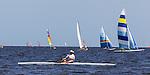 Boats sail and row off the beach at Shell Point Regatta during the 40th Annual Stephen C Smith Regatta April 27, 2013.<br /> &copy;2013 Mark Wallheiser