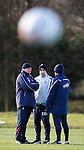 Walter Smith, Kenny McDowall and Ian Durrant have a team talk as the training balls fly overhead