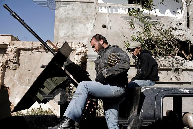 Rebel fighters use a gun in central Misurata behind Tripoli Street. On 17 February 2011 Libya saw the beginnings of a revolution against the 41 year regime of Col Muammar Gaddafi.
