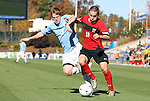 14 November 2010: Maryland's Casey Townsend (11) and Carolina's Dustin McCarty (7). The University of Maryland Terrapins defeated the University of North Carolina Tar Heels 1-0 at WakeMed Soccer Park in Cary, North Carolina in the ACC Men's Soccer Tournament Championship game.