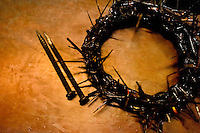 A crown of thorns is seen on the table at the end of the Good Friday procession during the Holy week in Lima, Peru, 30 March 2013. The annual Passion Of Christ procession, held as part of Easter celebrations, starts in Lima downtown and, followed by thousands of catholic believers, it climbs to the top of the dry and rocky hill of San Cristobal, where Mario Valencia, who has been playing the role of Jesus Christ for more than 30 years, is symbolically crucified.