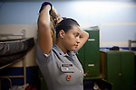 Police Pacification Unit (UPP) officer Mariana Gomes prepares for her patrol shift in Complexo do Caju, a complex of a newly pacified favelas in the North Zone, Rio de Janeiro, Brazil, on Saturday, April 27, 2013. <br /> <br /> In the early hours of Sunday, March 3, 2013, about 1,400 Brazilian security forces occupied 13 communities during a joint public security operation to install a Pacifying Police Unit (UPP) in two Rio de Janeiro favelas, Complexo do Caju and Barreira do Vasco. Elite police units backed by armored military vehicles and helicopters invaded the neighborhood in an on-going policing program aimed to drive violent and heavily armed drug gangs out of Rio's poor communities, where the traffickers have ruled for decades. For the community of Caju, that is ADA (Amigos de Amigos).