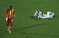 Andre Ayew of Ghana walks past a dejected Maurice Edu of USA. Ghana defeated the USA 2-1 in overtime in the 2010 FIFA World Cup at Royal Bafokeng Stadium in Rustenburg, South Africa on June 26, 2010.