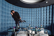 New York City, New York - October 3, 1988. French designer and architect Philippe Starck in the Royalton Hotel. This hotel is located east of Times Square, and was the first hotel designed by Starck.