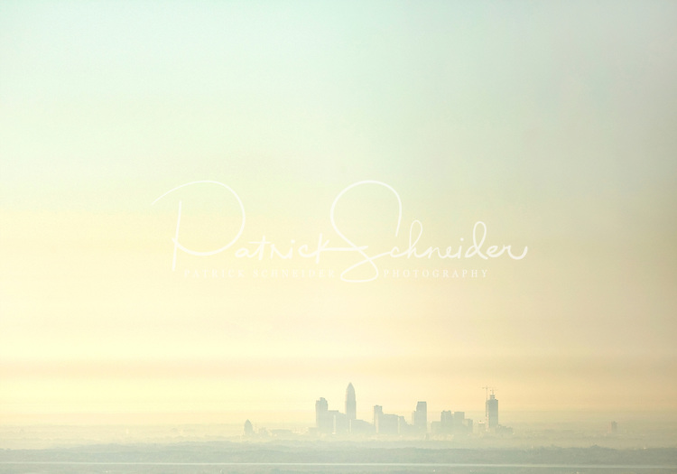 The Charlotte skyline appears mystical in an early morning mist.