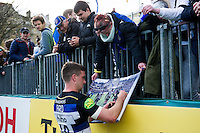 George Ford of Bath Rugby signs an autograph for a supporter after the match. Aviva Premiership match, between Bath Rugby and Sale Sharks on April 23, 2016 at the Recreation Ground in Bath, England. Photo by: Patrick Khachfe / Onside Images