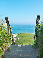 Rustic wooden steps descend from the beach house garden to the beach at Surfside on the south coast of Nantucket Island