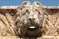 Carved relief with a lion's head from the Temple of Apollo, built 4th century BC, at Letoon, near Xanthos, Antalya, Turkey. The Temple of Apollo was decorated with Doric friezes and also had fine floor mosaics. The Letoon or Sanctuary of Leto was the sacred cult centre of Lycia, its most important sanctuary, and was dedicated to the 3 national deities of Lycia, Leto and her twin children Apollo and Artemis. Leto was also worshipped as a family deity and as the guardian of the tomb. The site is 10km South of the ancient city of Xanthos in Lycia, near the modern-day village of Kumluova, Fethiye. Founded in the 6th century BC, the Greek site also flourished throughout Roman times, and a church was built here in the Christian era. The site was abandoned in the 7th century AD. Picture by Manuel Cohen