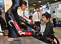 Nobember 9, 2011, Tokyo, Japan - Assist devices for upper arm are shown during the International Robot Exhibition 2011 opened in Tokyo on Wednesday, November 9, 2011. The three-day trade show, sponsored by the Japan Robot Association, was designed promote new products and develop new business through contributing the promotion of new technology. (Photo by Natsuki Sakai/AFLO) [3615] -mis-..